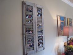 credit: Hooked on Houses [http://hookedonhouses.net/2009/12/04/creative-ways-to-display-family-photos/]