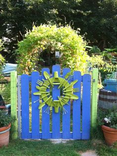Phillips' blue garden gate wreath made with old rusty broken tools and wood from an old shelf