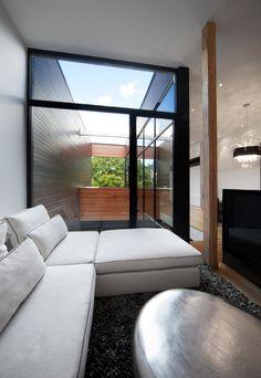 light filled living room  http://design-milk.com/houses-share-one-lot-montreal/