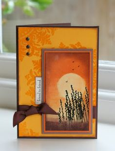 "By Jo Dumbleton. Background panel features the Medallion stamp, clear-embossed. Inset scene background masked & brayered. Stamp from Stampin' Up's ""Pocket Silhouettes"" set. Whole card sprayed with copper Glimmer Mist."