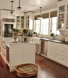 Love big windows by the kitchen sink.