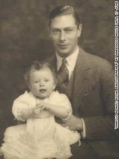 King George VI proudly sits for a photograph with his young daughter and future monarch, Queen Elizabeth II