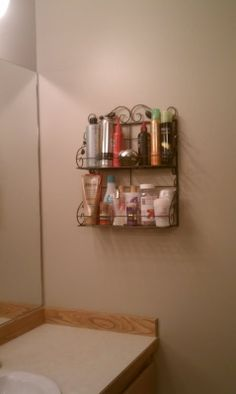 Great idea! - Spice rack as a bathroom organizer    Spent a whole twelve bucks at TJ Maxx and now when I wipe off the bathroom counters I don't have to pick up two dozen different bottles :) I'm pretty pleased