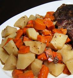 Crockpot Italian Beef Roast with Potatoes & Carrots --- 2 - 2 1/2 lb beef roasts, 7 Idaho potatoes peeled and diced into small cubes, 5 large carrots peeled and diced into small cubes, 1 pkg. Grill Mates Italian Herb Seasonings & Marinade, 1 tbsp. garlic powder , 2 c. beef broth