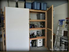 I love this pegboard on the door of the cabinet -- great idea for extra organization!