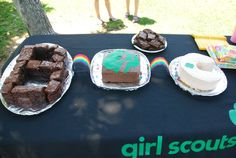 Girl Scout Bridging Cakes.  Brownies to Juniors to Cadettes.  Twizzler rainbows in between.  Cake Charms in the Junior & Cadette cakes for the bridging girls to make a wish and pull!