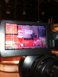 Our Christmas elf just HAD to be in our Christmas promo.