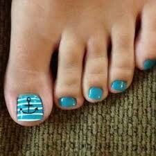 Turquoise and white anchor pedicure..
