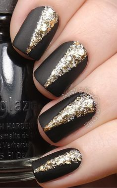 Elegant black and gold ensemble. There???s nothing more classic than black matte nail polish with gold embellishments on top to make just about any winter outfit stand out. Source