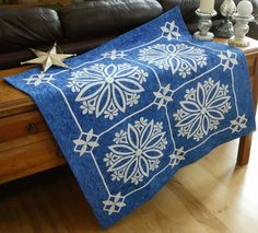 """Nordic Crystals"" is a quilt from Happy Stash Quilts featured in Quilters Newsletter's Best of Christmas 2014 issue."