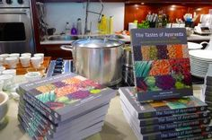 """Barbara Jo's Books for Cooks in Canada shows TASTES OF AYURVEDA (Arsenal Pulp Press) on display next to--what else!--cookware in the kitchen. >> See more behind the scenes photos from """"The Mysteries of Publishing Revealed"""""""