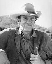 James Arness - American actor, best known for portraying Marshal Matt Dillon on Gunsmoke for 20 years. His brother was actor Peter Graves. Arness has the distinction of having played the role of Marshal Matt Dillon in five separate decades: 1955 to 1975 in the weekly series, then in Return to Dodge (1987) and four more made-for-TV Gunsmoke movies in the 1990s.    Served in WW2 and reported to Fort Snelling in March 1943. Arness served as a rifleman with the U.S. 3rd Infantry Division, and was severely wounded during Operation Shingle, at Anzio, Italy. Due to his height, he was the first ordered off his landing craft to determine the depth of the water; it came up to his waist. On January 29, 1945, having undergone surgery several times, Arness was honorably discharged. His wounds bothered him ever since, and in recent years Arness has suffered from acute leg pain. His decorations include the Bronze Star, Purple Heart; the European-African-Middle Eastern Campaign Medal with three bronze battle stars, the World War II Victory Medal and the Combat Infantryman Badge.