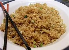 Cauliflower Fried Rice - Grate cauliflower, heat 1 TB. olive oil in pan, stir fry 1/4 cup chopped scallions and 2 tsp. garlic...add cauliflower, cook 4-5 mins...don't overcook..stir in 1 TB. soy...push over to side of pan and cook one egg, scrambling it.....mix together with cauliflower mixture...sprinkle with green onion tops...would be good with marinated chicken.....