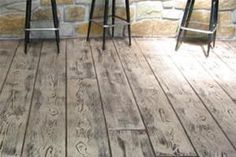 Stamped and stained concrete floor looks like wood.  Love this whitewashed effect.  So gorgeous!  Get this in a herringbone pattern and I'd swoon.
