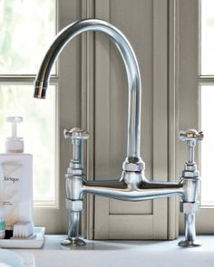 High gooseneck faucets make it easy to fill large pots and vases and to maneuver things in and out of the sink.