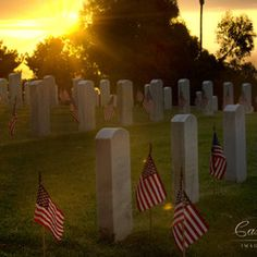 Boy Scouts and hundreds of other volunteers place flags on more than 80,000 grave sites at Fort Rosecrans National Cemetery in Point Loma.
