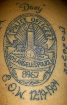 "This officer's tattoo honors his fallen twin brother Duane ""Duey"" Johnson, an LAPD officer who was killed in a 1984 gunfight in Chinatown. - www.policemag.com - #police"