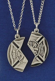 Fire Dept. Mizpah Pendant--One of these is worn by the firefighter and one by someone he or she loves. I used a pendant just like this in one of my firefighter books