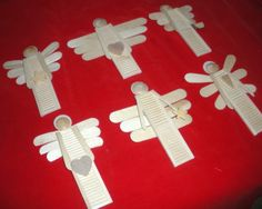 Got this idea from Pinterest. It was a tall garden angel made out of an old shutter. These ornaments are made out of dollhouse shutters, craft sticks, and wooden buttons.