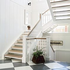 "Sizable windows by Marvin line the walls of the stairwell and the cupola to send natural light streaming down into the lower floors. ""The large stairwell is a great conduit for additional light; it makes the adjacent rooms feel more open,"" says Blore."