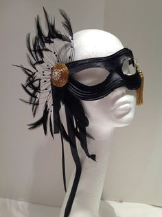 Hey, I found this really awesome Etsy listing at https://www.etsy.com/listing/178709547/black-mask-black-and-gold-feather-mask