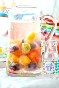 Cute party drink! Freeze fruit and juice in trays! Recipe via Kara's Party Ideas KarasPartyIdeas.com #party #fruit #rainbow #drink #idea