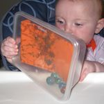 Marble Painting for Baby-put paper and marbles and paint in clear tupperware, let them roll around