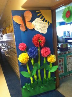 """We're Blooming Into Great Readers!"" - A lovely idea for a spring classroom door display."