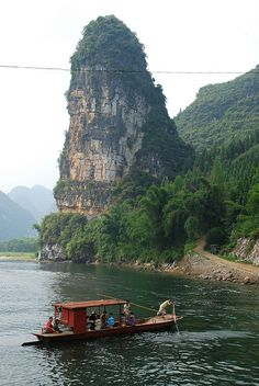 Guilin, China - Li River There's a boat cruise on this amazing river with its awesome mountains!