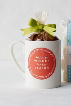 """For a warm gift, fill a mug with cocoa mix, then print a """"Warm Wishes for the Season"""" sticker on adhesive paper. Click to print the template, courtesy of HP"""