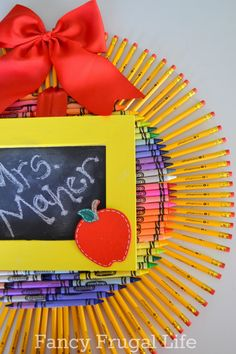 I'm totally doing this for my own classroom when I eventually have one :) Fancy Frugal Life: Crayon & Pencil Wreath (Back to School Craft)