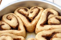Heart Cinnamon Rolls- use a standard recipe then place dough on a lightly floured surface. Roll out into a rectangle, about 13 inches in length. Using an off-set spatula, apply butter and sprinkle with cinnamon and sugar. To roll the dough, roll in each long side towards the middle. Cut the log into twelve 1-inch rolls. Pinch the bottom of each roll to make the bottom point of the heart. Place six rolls in each pan, spaced slightly apart.
