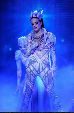 Katy Perry Catsuit.  Designed by CuteCircuit. White catsuit adorned with LEDs and crystals.  Wearable Tech: Future Couture | ZDNet
