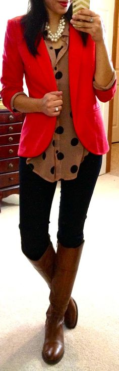 triple layered pearl necklace - long sleeve brown/black polka dotted draped sheer top - full size bright red blazer - black skinny jeans - light brown riding boots