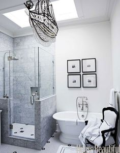 A bathroom with a crystal ship chandelier. Design: Ken Fulk