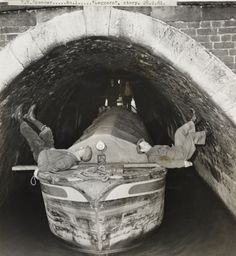 Expert leggers Daniel Jinks and Ernest Wood.    The two men demonstrate the process of 'legging' through Barnton Tunnel on the Trent and Mersey Canal. Early canal tunnels had no tow-paths, so to propel the boat through the tunnel two people had to lay on their backs on the boat, and push the boat along using their feet on wall of the tunnel. The Barnton Tunnel was over 500 yards long.