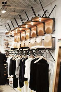boutique display. Cool use of chairs on the wall!