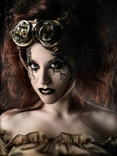 Steampunk inspired fantasy make-up in hues of brown and gold enhanced with crystals.