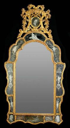 A magnificent Venetian Rococo carved giltwood etched mirror, mid 18th century,