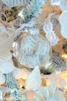 Cut up strips of paper inside a clear ornament! DIY via Kara's Party Ideas #sparkleparty