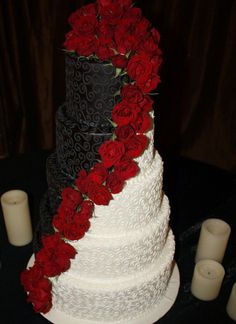 This is a very unique version of a wedding cake, and since I'm such a corky individual, I thought this would be something that would be a bit simple, but still over the top (Plus, I believe these are real roses). Neat ! black weddings, color, black white, red roses, white weddings, white cakes, white wedding cakes, red black, red wedding