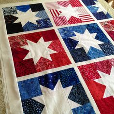 This is a different look, with the stars being all white and the background scrappy blues and reds.  Cute for little boys, too.....or little girls who are fans of red, white, and blue.