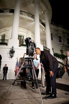Boatful of Stargazers: President Obama looks through a telescope at the White House Star Party in 2009.