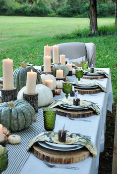 Autumn dinner -- outdoors, with white and blue-green pumpkins and log slices. Great fall party decor! (from Life of Splendor)