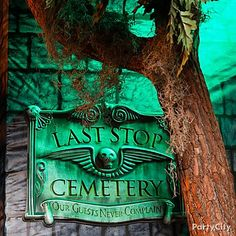 Use colored lightbulbs to cast an eerie glow on Halloween decorations like spooky signs.
