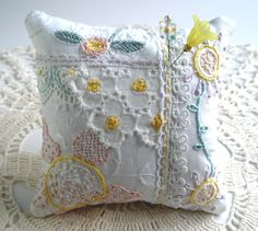 Pincushion, White Whispers and Embroidered Posies.
