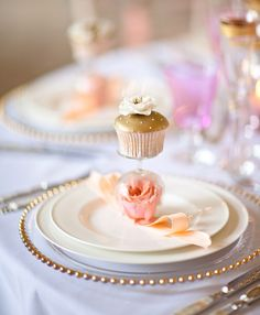 Pastel pink and gold dessert table setting