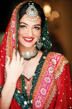 That maang tika ('maang' meaning hair partition; and 'tika' meaning a mark on the forehead, same as 'tilak') in silver and green is big, but so gorgeous! --- #indian #wedding #jewelry