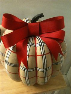 Burberry Pumpkin. Paint tan, use paint markers to draw the plaid pattern and add bow