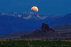 "Partial lunar eclipse, June 2012. In the foreground is a tributary of the Shoshone River, with the Absaroka Mountains near Cody, Wyoming, USA. Beautiful shot of the Moon against a stunning landscape. (Photo & copyright:  Mack H. Frost) ©Mona Evans, ""Lunar Eclipses"" http://www.bellaonline.com/articles/art28454.asp"